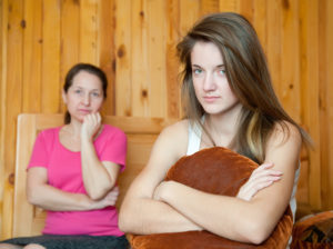teenager and mother after quarrel